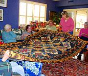 Admiring a quilt