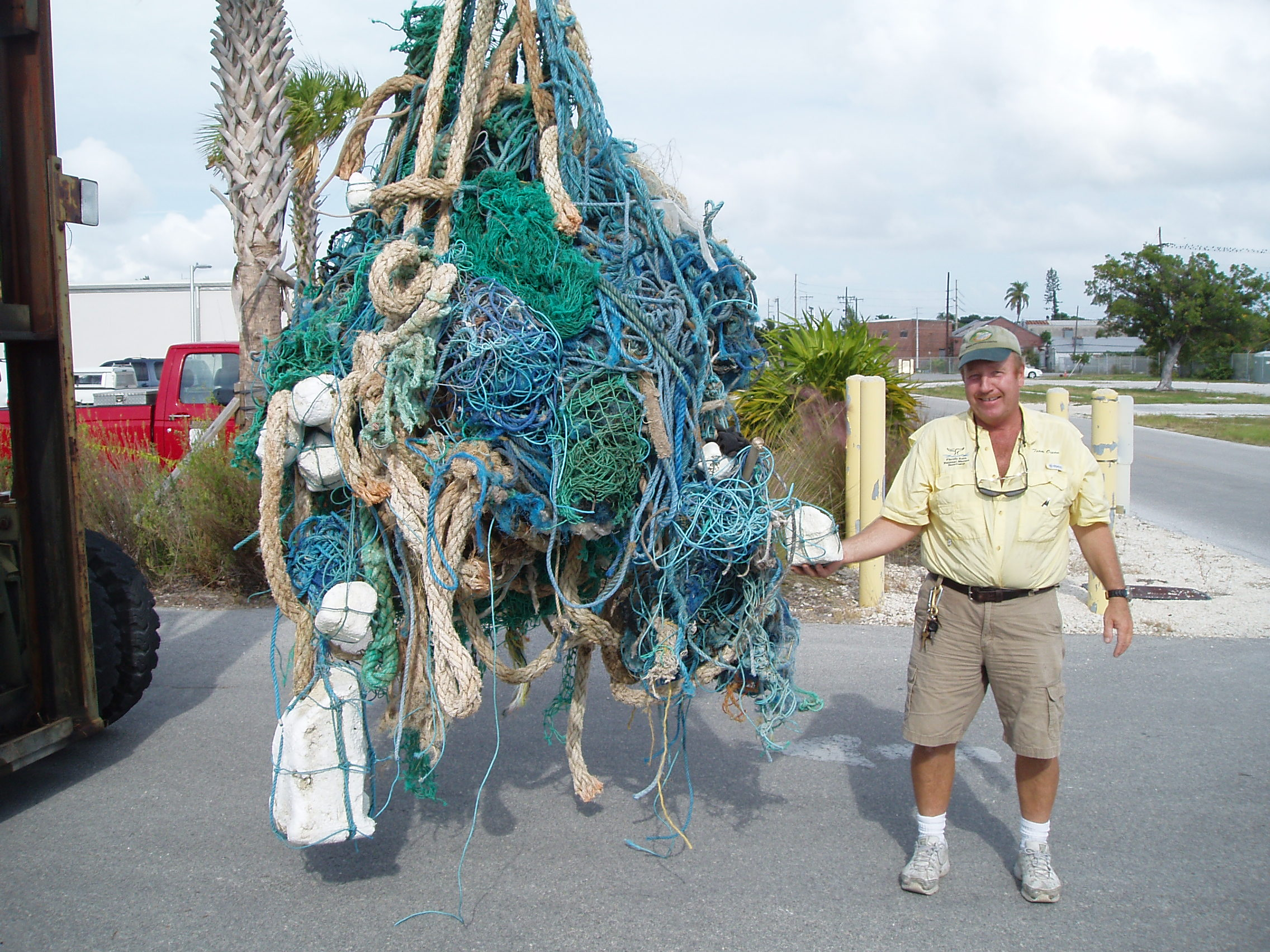 Robert Keeley poses with 450 pounds of marine debris
