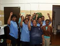 hosptial workers with fists raised.jpg